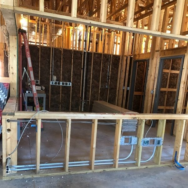 New construction building, framed in and electrical for the new Service Counter and Workspace